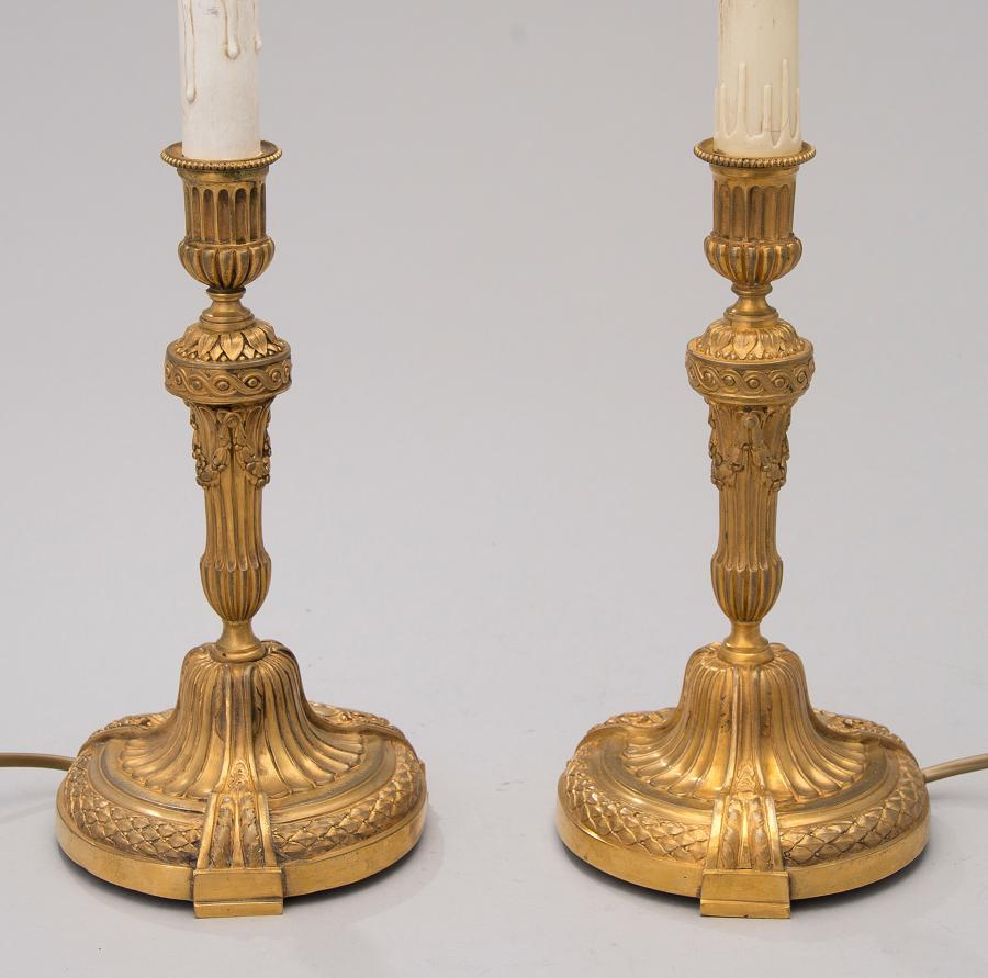 A pair Jollet et Cie of gilt bronze table lamps