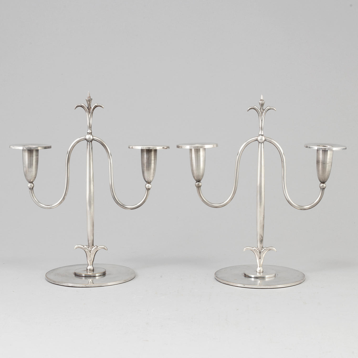 ELIS BERGH, a pair of silver plate candelabra