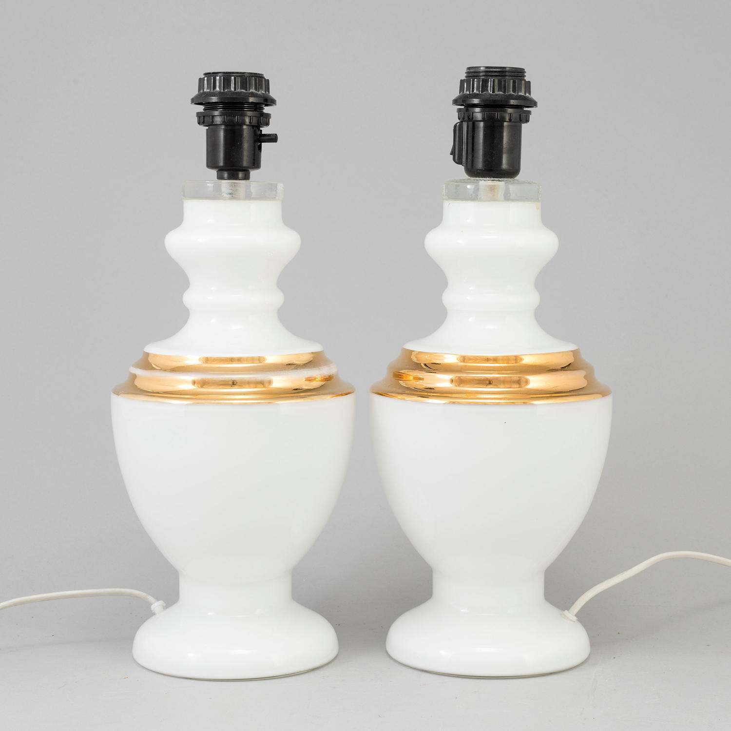 A pair of white opaline glass table lamps