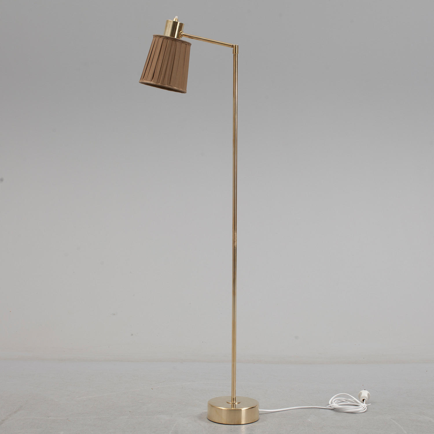 A Swedish brass swing arm standard lamp