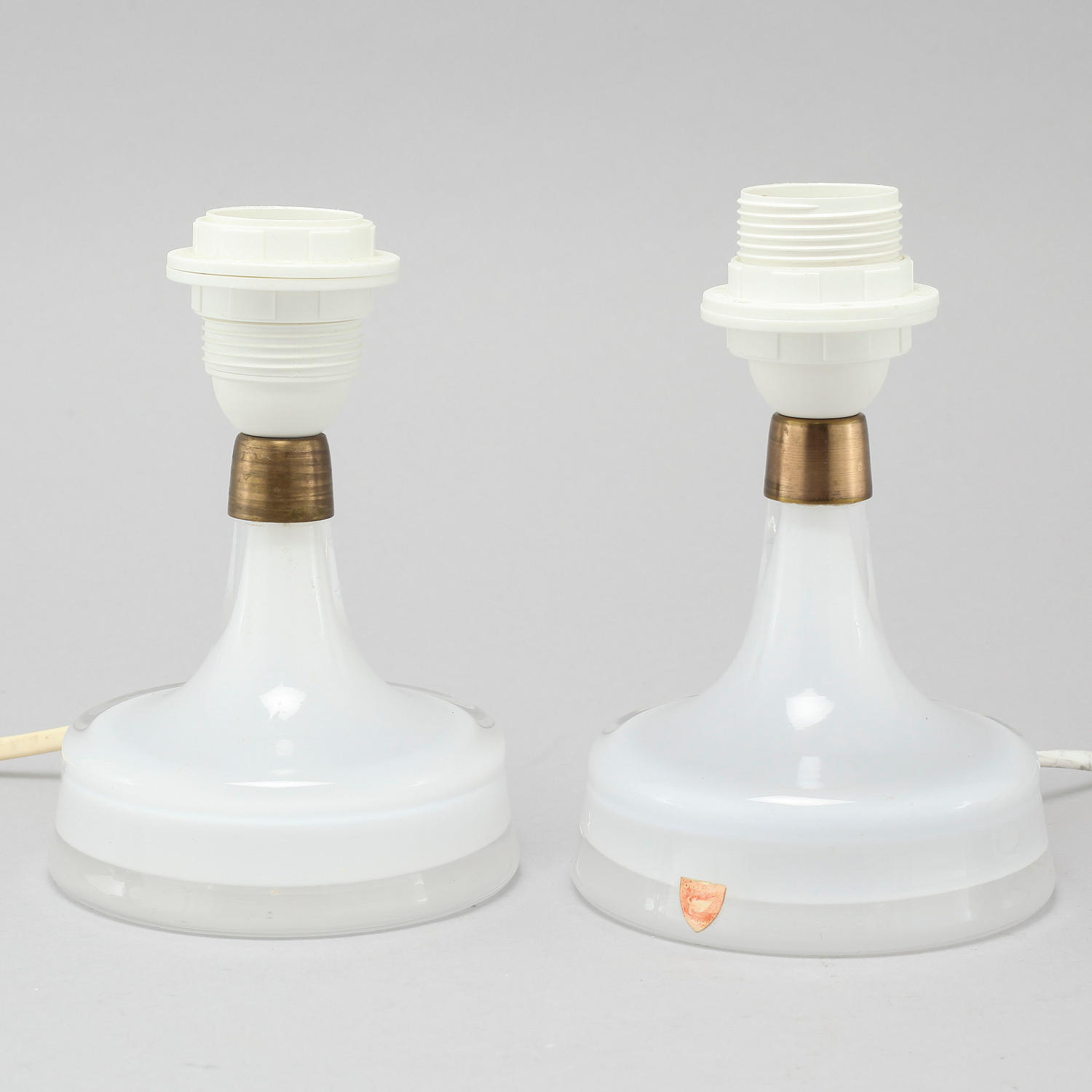A pair of small Orrefors glass table lamps
